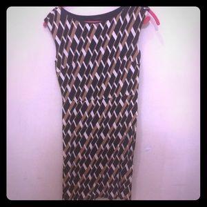 Navy tan and white geometric print dress